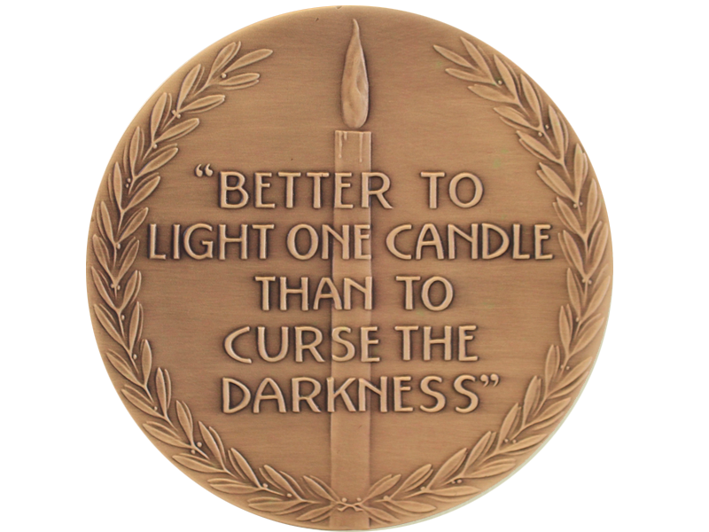 Christopher Award quote - Better to light one candle than to curse the darkness.
